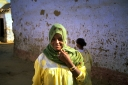 Nubian woman in green scarf