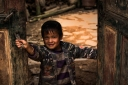Hani child in door~ Mushroom village~Yunnan