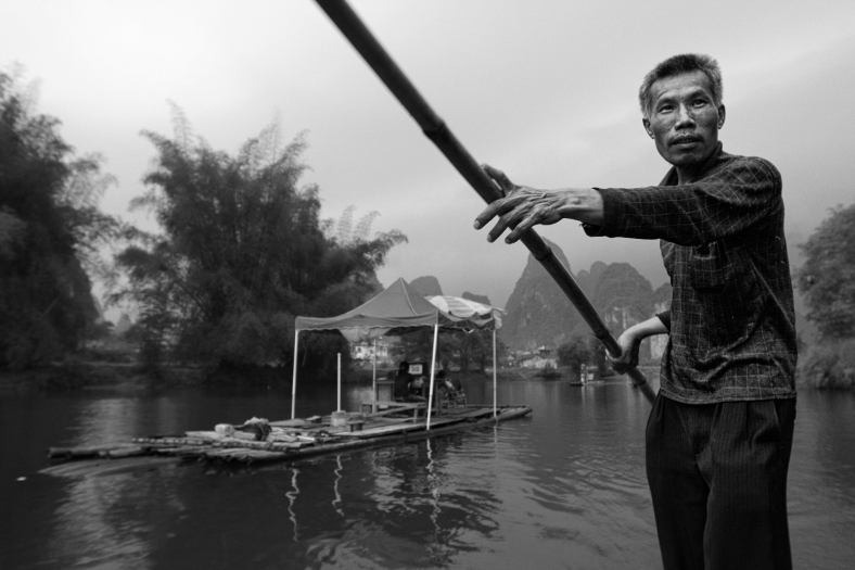 raft man~ Li river~ Guilin