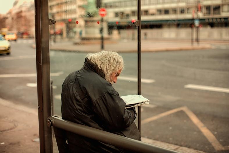 man at bus stop~ Paris