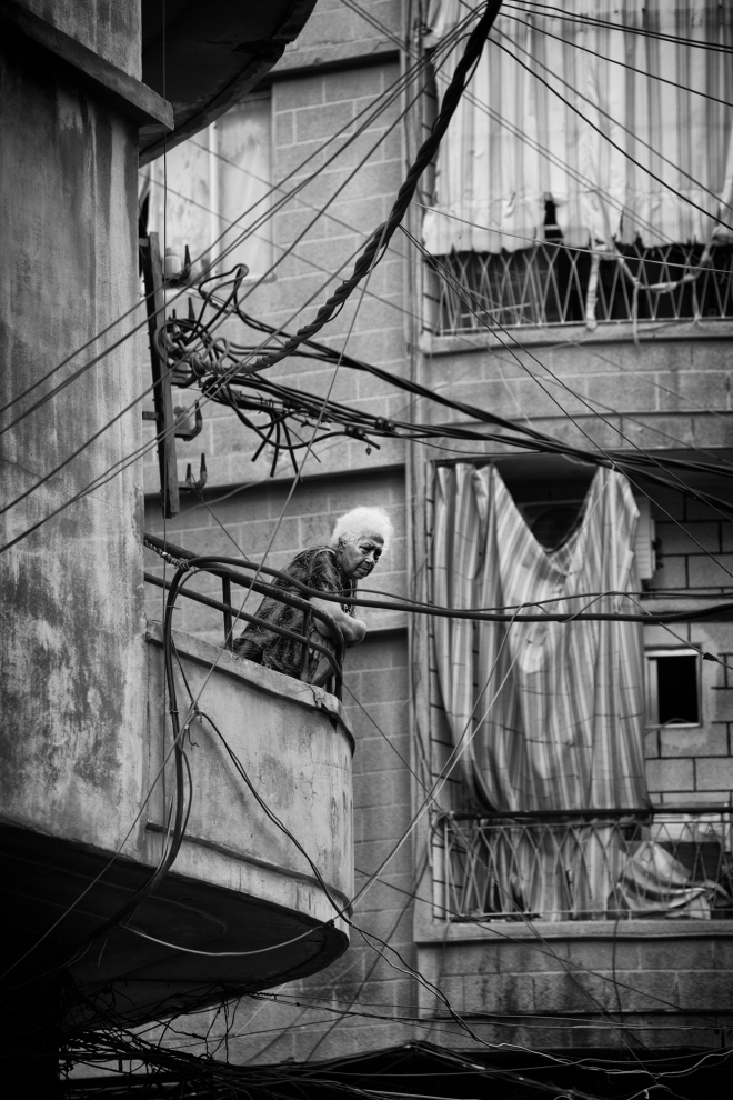 Lady on her balcony in the area of Borj Hammoud, Beirut
